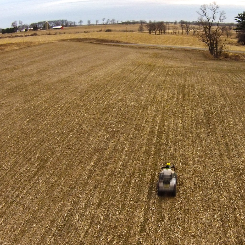 Frost seeding red clover in winter wheat using an ATV.